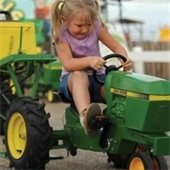girl rides tractor