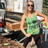 girl pitchforks compost