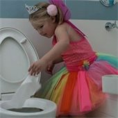 girl flushing baby wipe