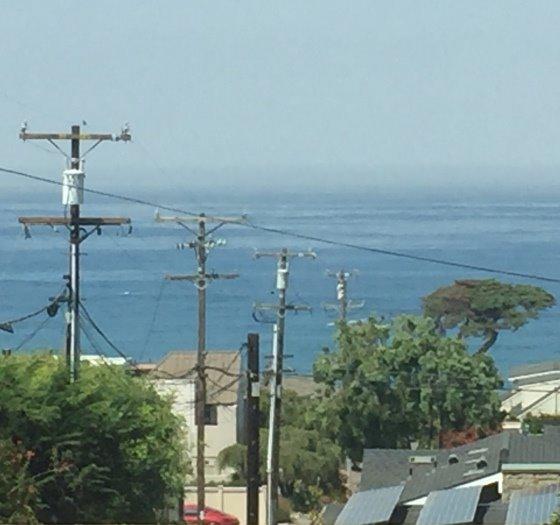 utility poles in ocean view