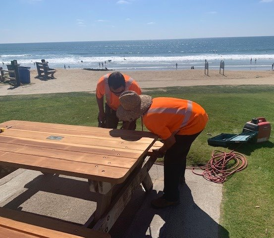 installing refurbished picnic table at Powerhouse Park