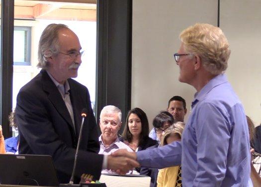 Mayor Dave Druker congratulates Eric Sandy