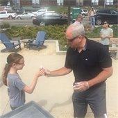 Scott Huth serves an ice cream cone