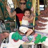girl and mom on carousel