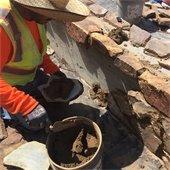stone masons working