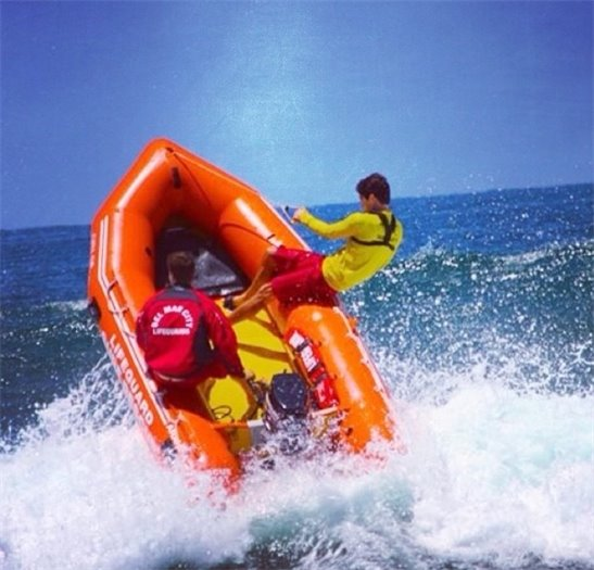 lifeguards pilot inflatable rescue boat