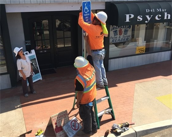 workers install signs