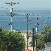 utility poles blocking ocean view