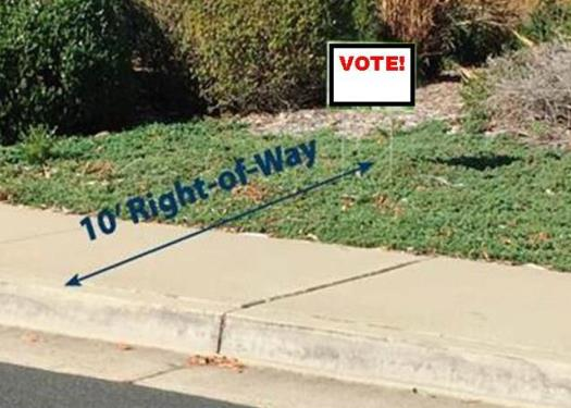 campaign sign next to right of way